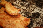picture of roasted pork  - Pork roast on the stove at the market  - JPG
