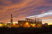 stock photo of fiery  - A steel plant under a fiery red evening sky - JPG