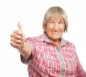 foto of 70-year-old  - Old happy woman showing ok sign on a white background - JPG