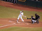 A's Batter Daric Barton Swings At Incoming Pitch