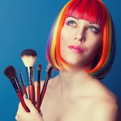 foto of wig  - beautiful woman wearing colorful wig and holding make - JPG
