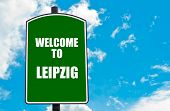 picture of leipzig  - Green road sign with greeting message WELCOME TO LEIPZIG GERMANY isolated over clear blue sky background with available copy space - JPG