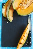image of cantaloupe  - Cantaloupe Melon Slices on black board with copy space - JPG