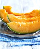 image of cantaloupe  - Cantaloupe Melon Slices On Metal Rustic Plate - JPG
