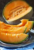 picture of cantaloupe  - Cantaloupe Melon slices on vintage metal plate - JPG