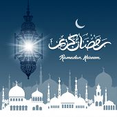 pic of kareem  - Ramadan Kareem greeting with beautiful illuminated arabic lamp and hand drawn calligraphy lettering on night cityscape background - JPG