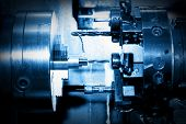 stock photo of boring  - Industrial CNC drilling and boring machine at work close - JPG