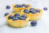 foto of curd  - Tartlets with lemon curd and blueberries closeup  - JPG