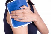stock photo of cold-shoulder  - woman putting an ice pack on her shoulder pain - JPG