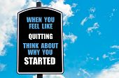 stock photo of start over  - WHEN YOU FEEL LIKE QUITTING THINK ABOUT WHY YOU STARTED motivational quote written on road sign isolated over clear blue sky background with available copy space - JPG