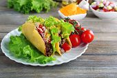 picture of tacos  - Tasty taco with vegetables on plate on table close up - JPG