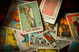 pic of divine  - A pile of tarot trump cards jumbled scattered and haphazardly arranged - JPG