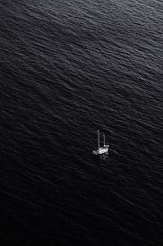 image of crimea  - Traveling yacht in the dark water of Black sea. 
