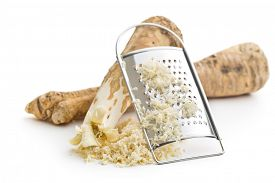 stock photo of grated radish  - grated horseradish root on white background - JPG