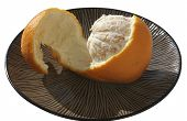 Half Peeled Orange On A Plate