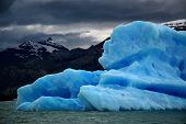 Iceberg Under Cloudy Sky