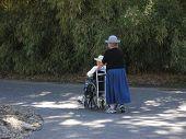Disabled Senior Women On A Walk