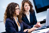 Young businesswomen working together in business team on laptop computer in meeting room at office.