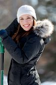 Smiling Woman With Snow Shovel