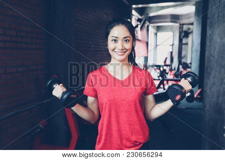 poster of Beautiful Muscular Fit Woman Exercising Building Muscles And Fitness Woman Doing Exercises In The Gy