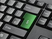 A Black Keyboard With Green Key Labelled $