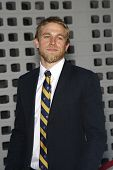 LOS ANGELES, CA - AUGUST 30: Charlie Hunnam at the FX's 'Sons Of Anarchy' season 4 premiere at the ArcLight Cinemas Cinerama Dome on August 30, 2011 in Los Angeles, California