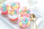 Unicorn Cupcakes Frosting With Pastel Color Butter Cream Serve With Milk. poster