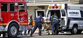 MALIBU, CALIFORNIA/USA - AUGUST 27, 2011: Unidentified firefighters help the victim of car accident