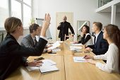 Businesswoman Raising Hand Up At Diverse Team Meeting Sitting At Conference Table, Student Asking Se poster