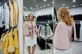 Elegance Blonde Girl In Coat At The Store Of Fur Coats And Leather Jackets. poster