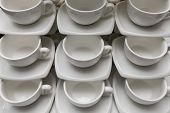 Many Rows Clean White Coffee Cup, Tea Spoon And Saucer On Table. Empty Mug Set In Row Prepare For Co poster