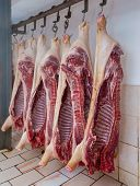 Slaughter Of A Pig, Carcasses Of Pigs, Ham Pork, Hanged Carcasses Of Pigs poster