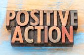 positive action - word abstract in vintage letterpress printing blocks poster