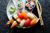 Sushi Plate With Sushi Set Nigiri And Sushi Rolls , Maki, Soy Sauce, Wasabi, Chopsticks poster