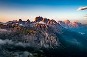 National Nature Park Tre Cime In the Dolomites Alps. Beautiful nature of Italy. Aerial FPV drone fli poster