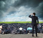 Businessman Searches Far For Clean And Green Environment. Overcome The Global Pollution Problem poster