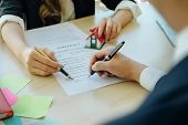 Agreement Paper,estate Agent Gives Pen And Documents Agreement With Customer To Sign Contract. poster