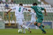 KAPOSVAR, HUNGARY - AUGUST 27: Pedro Sass (green 33) in action at a Hungarian National Championship soccer game - Kaposvar (green) vs Paks (white) on August 27, 2011 in Kaposvar, Hungary.