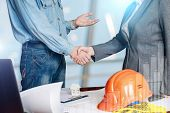 Handshake Of A Businessman And Builder . The Concept Of Success In Cooperation. poster