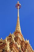picture of ziggurat  - Nice temple in gold colour in Phuket thailand - JPG