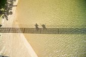 Shadow Of Couple On Water