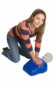 stock photo of cpr  - Pretty young lady using cpr taining dummy - JPG