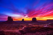 Dramatic And Very Colorful Sunrise Over Monument Valley In Arizona, Usa. Long Exposure. poster