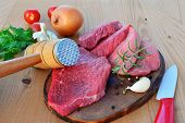 Red Meat Slices On Wooden Board Tendered With A Meat Pounder. Veal Beef Slices Ready For Schnitzel O poster