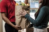 Smart Food Delivery Service Man In Red Uniform Handing Fresh Food To Recipient And Young Woman Custo poster