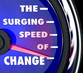 The words Surging Speed of Change on a blue speedometer with needle racing to represent the growing power and rapid pace of advancements and evolution