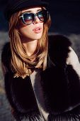 Beautiful Woman In Fur, Urban Style Accessories And Sunglasses. Lynx Fur Fashion Beauty. Model Looki poster