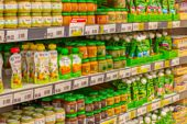 Defocused Background, Baby Food Supermarket Shelves, Fruit Puree And Porridge For Feeding Small Chil poster
