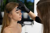Young Beautician Caucasian Girl Holds Model Eyebrow Correction Beautician At Work Is The Workplace O poster