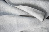 Waves On Tissue Folds On A Piece Of Tissue Surface. Folds Of Cotton Fabric. Warm Coat. Beautiful Tex poster